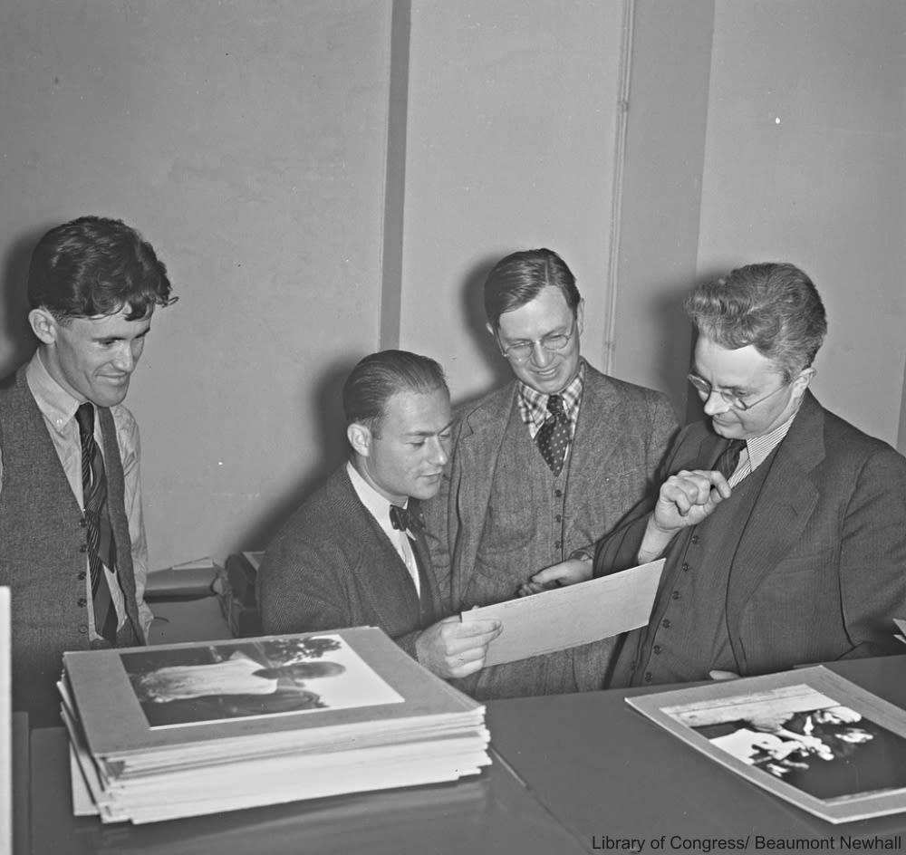 Roy Stryker (right), speaks with FSA photographers   John Vachon, Arthur Rothstein and Russell Lee