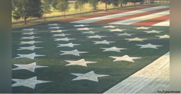 For years, a 300-by-600-foot flag was painted on Bob Burr's front yard.