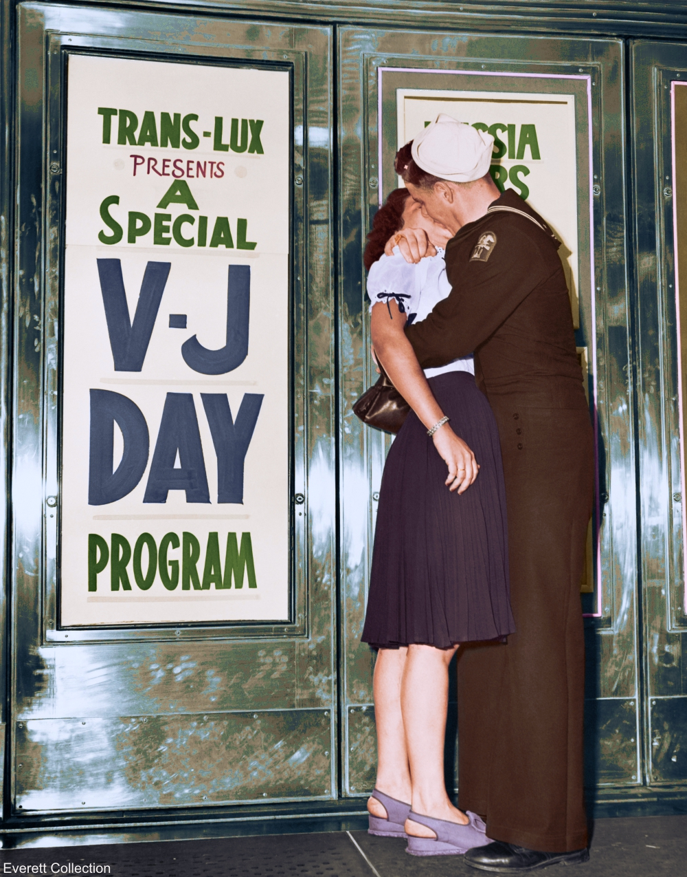 V-J Day Sailor Kissing a Young Woman