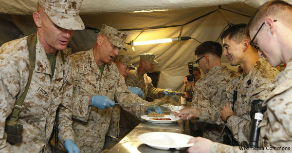 Paxton serves troops in a mess tent.