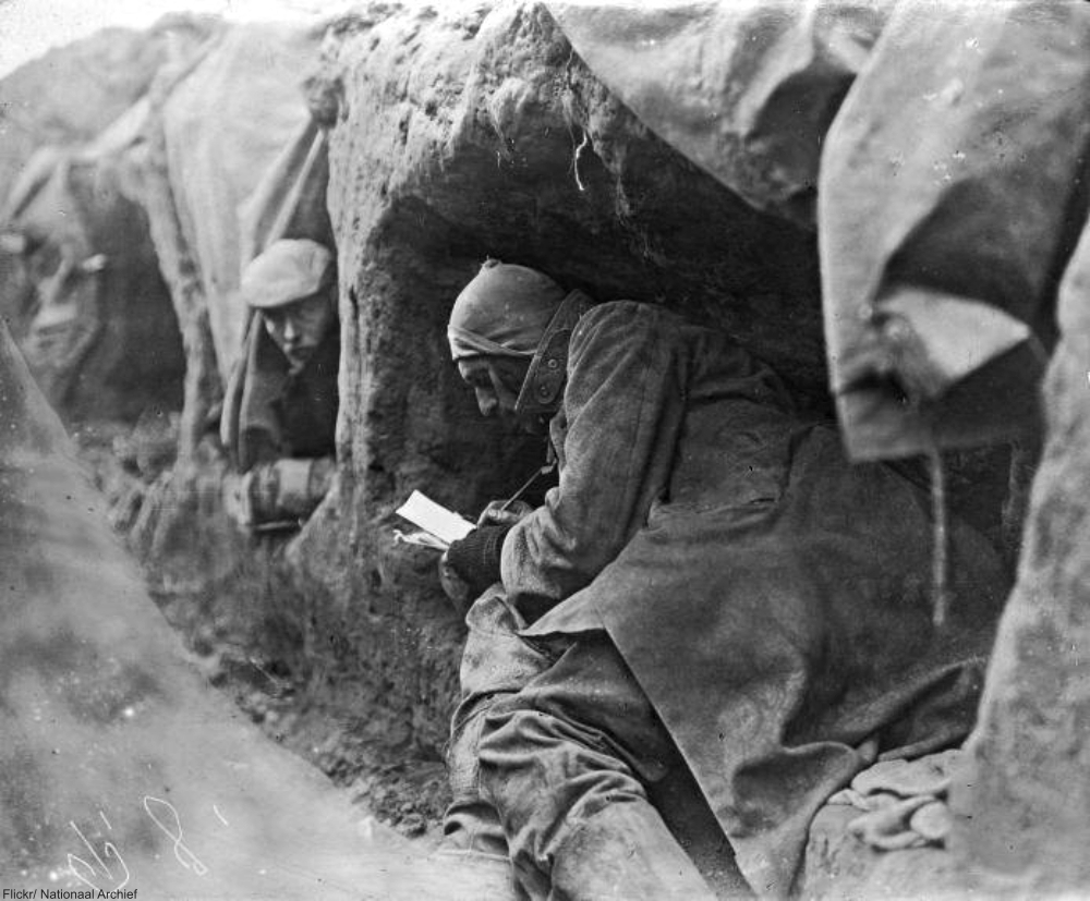 Writing letters home in the trenches circa 1914