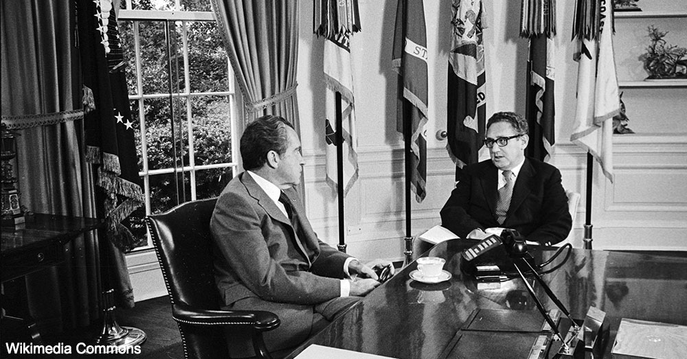Richard M. Nixon speaks with Henry Kissinger.