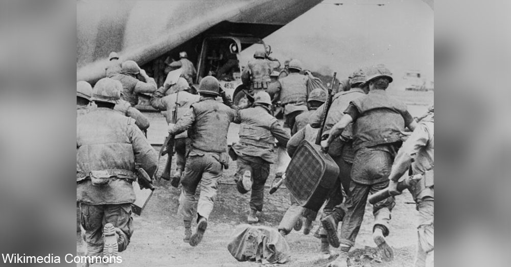 Soldiers and civilians run for the final evacuation of Khe Sanh.
