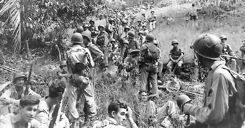 Source: Wikimedia Commons Marines rest in a field on Guadalcanal.
