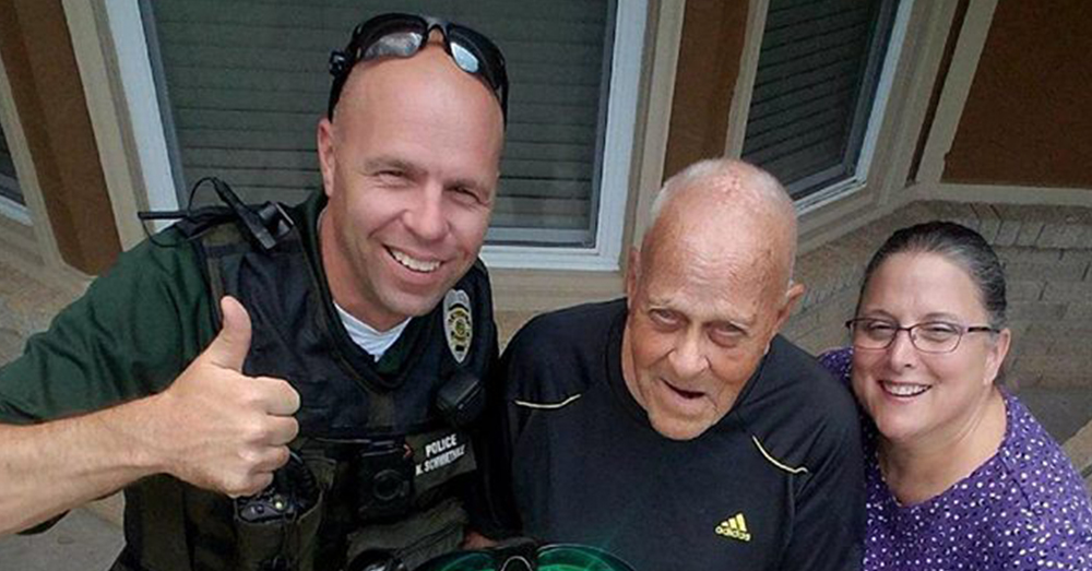 Photo: Facebook/Wichita Police Department North Bureau -- Officer Robert Bachman with WWII veteran Charles Johnson.