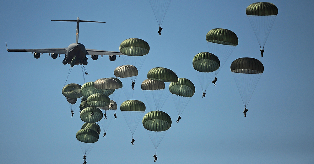 Photo: U.S. Air Force/A1C James Richardson -- 82nd Airborne Division Paratroopers blanket the sky as they descend from a C-17 Globemaster.