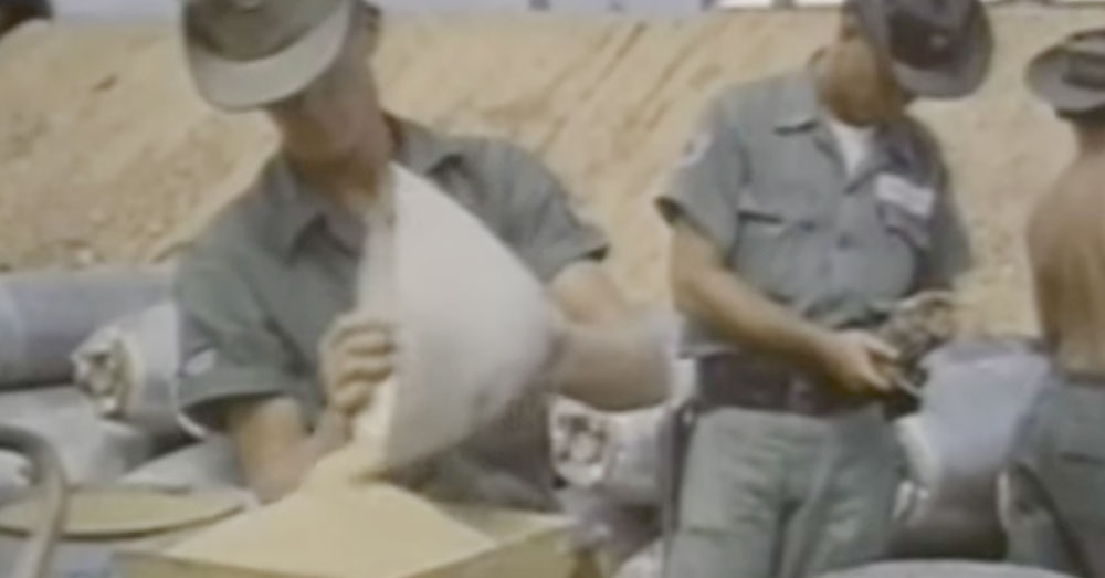 Source: YouTube/Newsy Soldiers dispense Agent Orange into barrels.