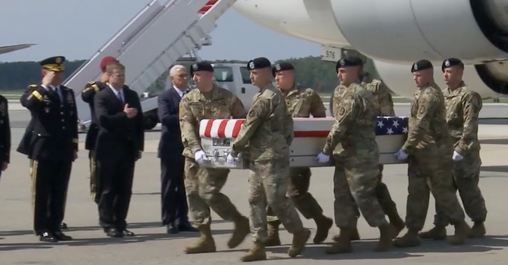 Photo: U.S. Air Force/Tech. Sgt. Holly Roberts-Davis -- Army personnel carry the remains of the two soldiers during a dignified transfer at Dover Air Force Base.