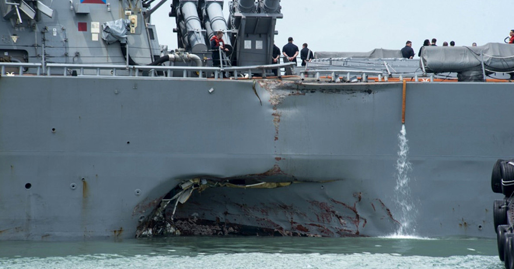 Photo: U.S. Navy/Mass Communications Specialist 2nd Class Joshua Fulton -- Damage to the USS John S. McCain can be seen at the waterline.