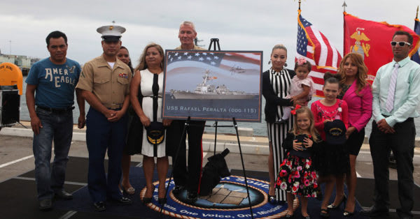 Source: Wikimedia Commons Marine Expeditionary Force commanding general, Lt. Gen. John A. Toolan and the family of Navy Cross recipient Sgt. Rafael Peralta.