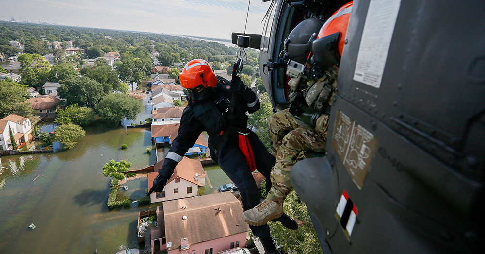 Photo: National Guard/Staff Sgt. Daniel J. Martinez -- National Guard rescue specialists help flood victims in Texas after Hurricane Harvey last week.