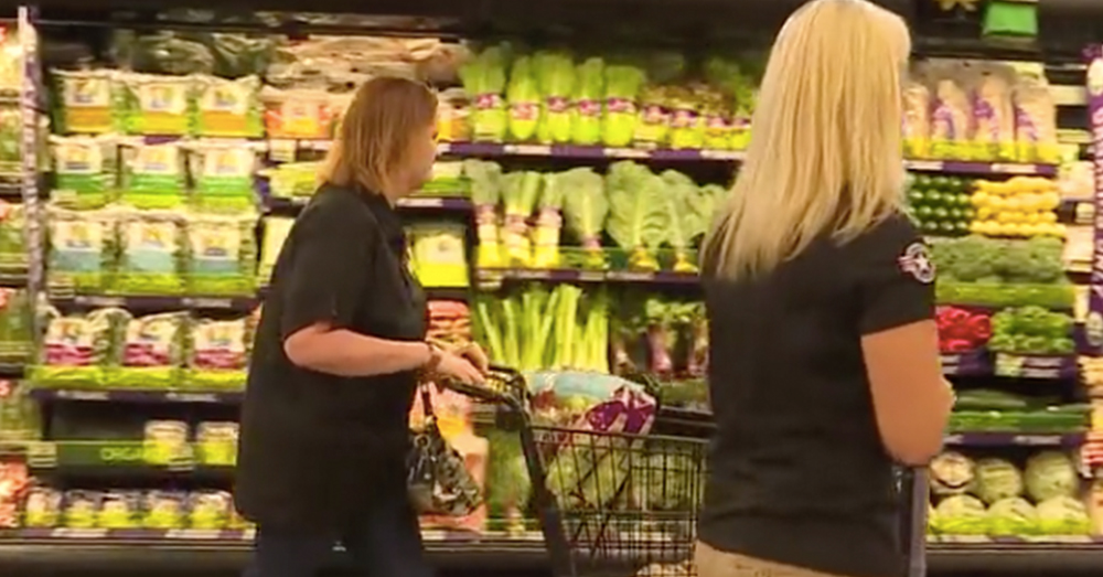 Photo: ABC 6 Screenshot -- Christina Rogers and a member of Operation Homefront start shopping for family groceries at Albertsons.