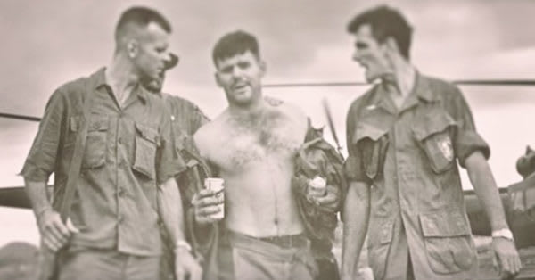 Source: YouTube/The U.S. Army Capt. Gary Rose (center) is carried by his fellow service members after treating 16 soldiers during Operation Tailwind.