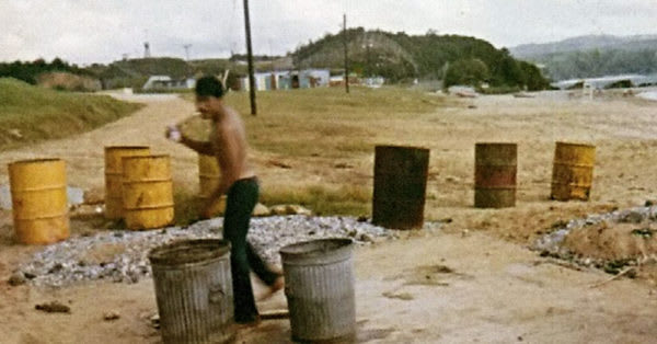 Source: Wikimedia Commons Agent Orange barrels and Marine Scott Parton on Okinawa 1971.
