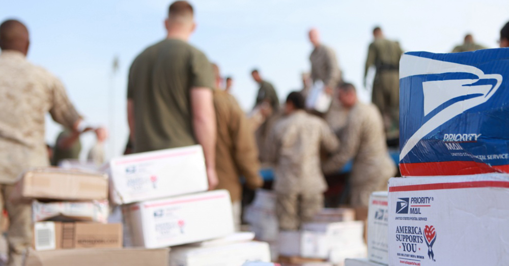 Photo: U.S. Marine Corps/Lance Cpl. Samuel Nives -- Service members of 3rd Marine Aircraft Wing (Forward) sort out mail and care packages aboard Camp Leatherneck, Afghanistan during the holiday season.