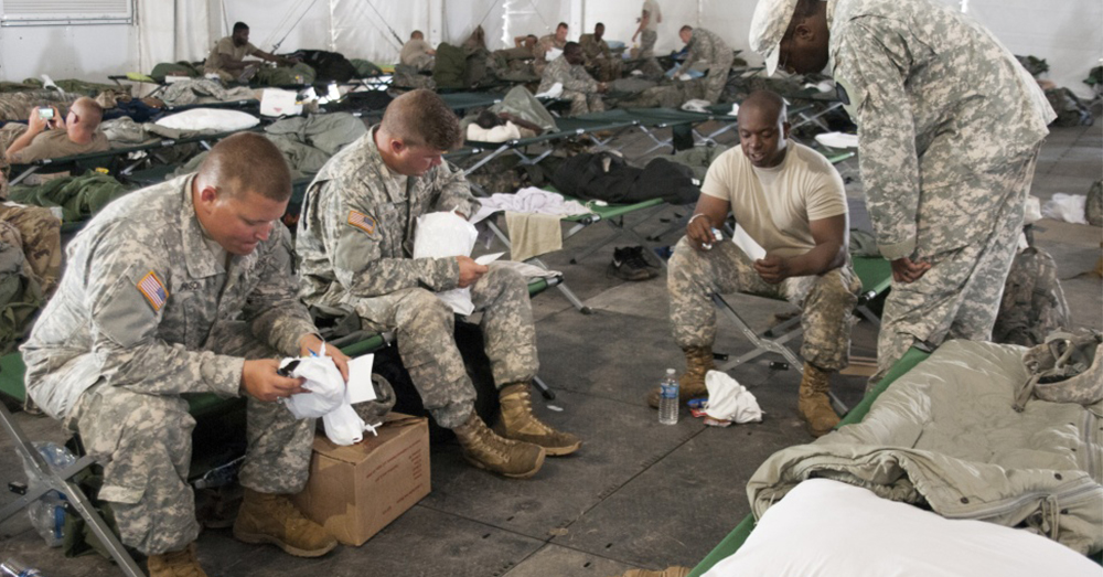 Photo: U.S. Army National Guard/Staff. Sgt. Armando Vasquez -- South Carolina National Guard Soldiers read letters that were included in care packages.