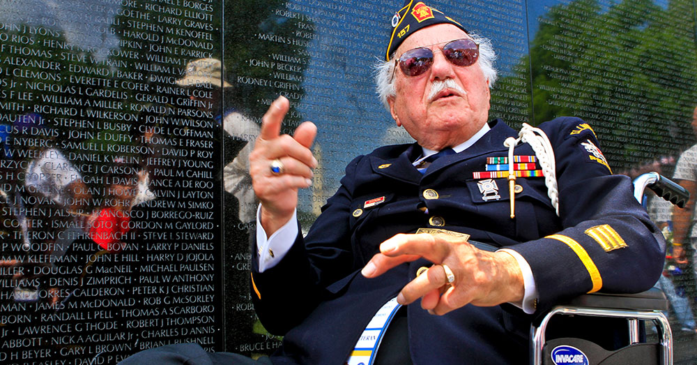 Source: Wikimedia Commons World War II Army veteran Samuel Teolis of Ellwood City, Pa., visits the Vietnam Veterans Memorial.