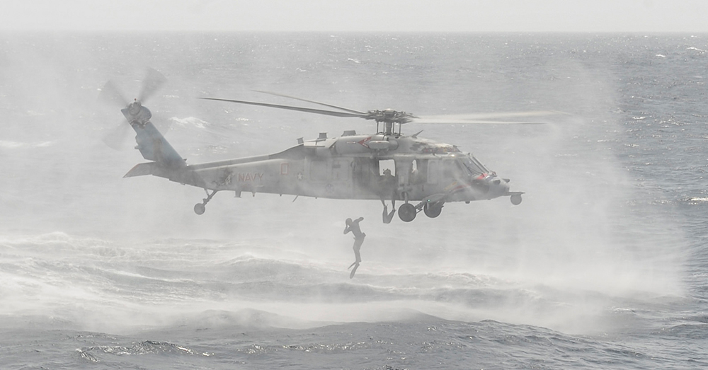 Photo: U.S. Navy/Mass Communication Specialist 3rd Class Jess Lewis -- An explosive ordnance disposalman (EOD) 11 jumps from an MH-60S Sea Hawk helicopter.