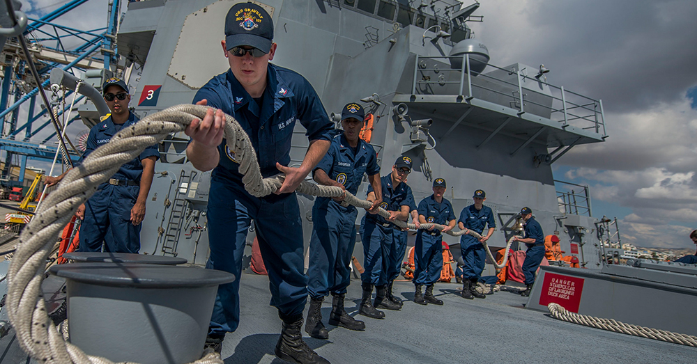 Photo: U.S. Navy/Mass Communication Specialist 2nd Class James Turner -- Sailors handle a mooring line aboard the guided-missile destroyer USS Gravely.
