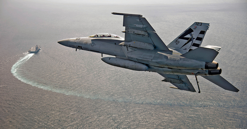 Photo: U.S. Navy/Erik Hildebrandt -- An F/A-18F Super Hornet approaches the aircraft carrier USS Gerald R. Ford.