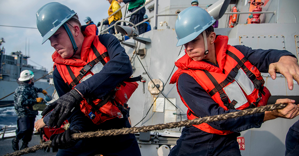 Photo: U.S. Navy/Mass Communication Specialist 2nd Class Marcus L. Stanley -- Sailors aboard the guided-missile destroyer USS Chung-Hoon (DDG 93) haul in handling line during a replenishment-at-sea.
