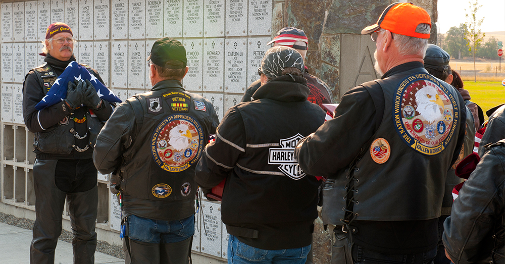 Photo: U.S. Air Force/Staff Sgt. Michael Means -- Members of the Patriot Guard Riders escort the unclaimed remains of 20 veterans and one spouse to their final resting place in 2012.