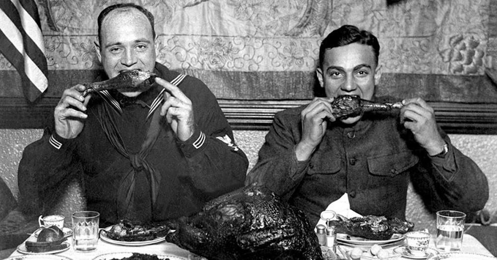 Photo: National Archives/War Department -- A Sailor and a Doughboy enjoy turkey for Thanksgiving during World War I.