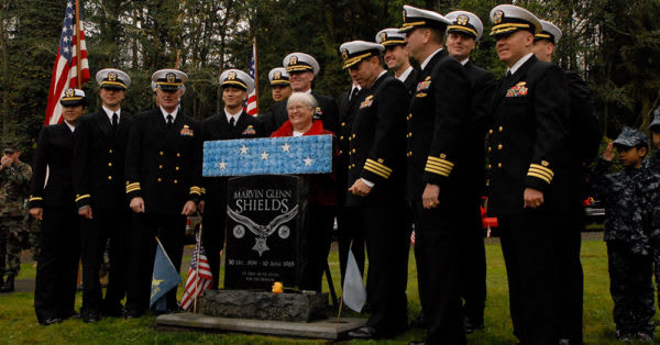 Source: Wikimedia Commons Joan Shields-Bennett poses with Navy leadership after a memorial service to honor her late husband, Navy Medal of Honor recipient Construction Mechanic 3rd Class Marvin G. Shields, on Veteran's Day at Gardiner Community Center cemetery.