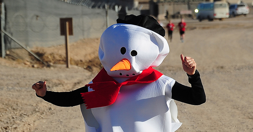 Photo: Australian Army/LS Andrew Dakin -- On Christmas Eve, soldiers and civilians dressed in attire ranging from Army physical fitness uniforms to holiday snowman and angel costumes raised over $2,000 for the Smith Family Charity during the Candy Cane 5K Fun Run at Multi National Base Tarin Kot, Afghanistan.