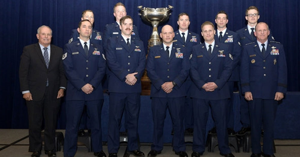 Source: U.S. Air Force The crew of Spooky 43, the AC-130U gunship, are joined by Air Force Vice Chief of Staff Gen. Stephen Wilson, right, and retired Lt. Gen. Stephen Wood, left, after they were awarded the Mackay Trophy Thursday. (Staff Sgt. Rusty Frank/Air Force)