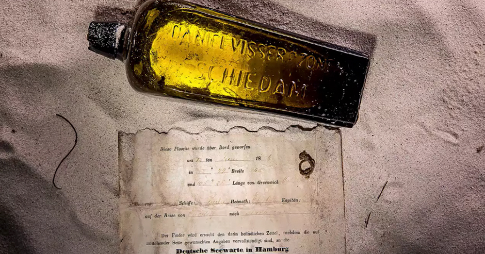 Screenshot: YouTube/Kym Illman -- This Dutch gin bottle with a note inside was found after being sent adrift by a German vessel in 1886.
