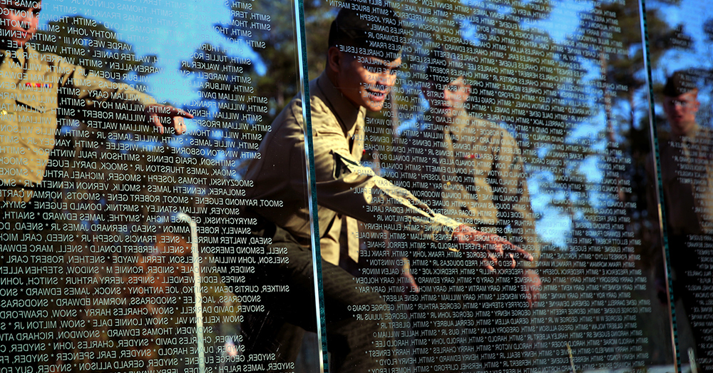 Photo: U.S. Marine Corps/Lance Cpl. Neysa Huertas Quinone -- Marines point out names at the Onslow County Vietnam Veterans Memorial.
