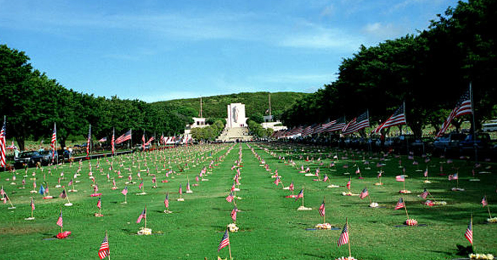 Flags and flower leis adorn each grave in the National Memorial Cemetery of the Pacific