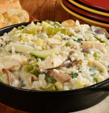 Chicken Risotto in a cast iron skillet with a baguette