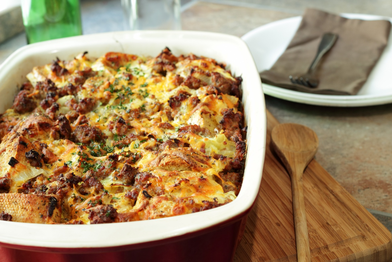 Savory breakfast casserole next to wooden spoon