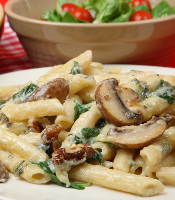 Rigatoni pasta with four cheese sauce, mushrooms and spinach