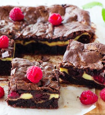 Chocolate brownie with raspberries and mascarpone.