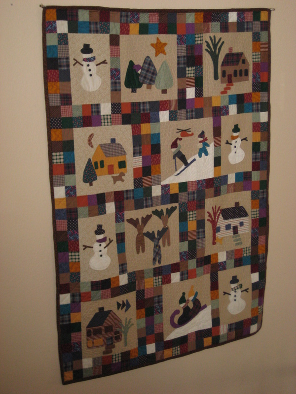 from: Kay Funk: This is based on a pattern called Snowbound but I personalized it. It includes family houses and our kids. I'm peeking out behind a tree. Can you find me?