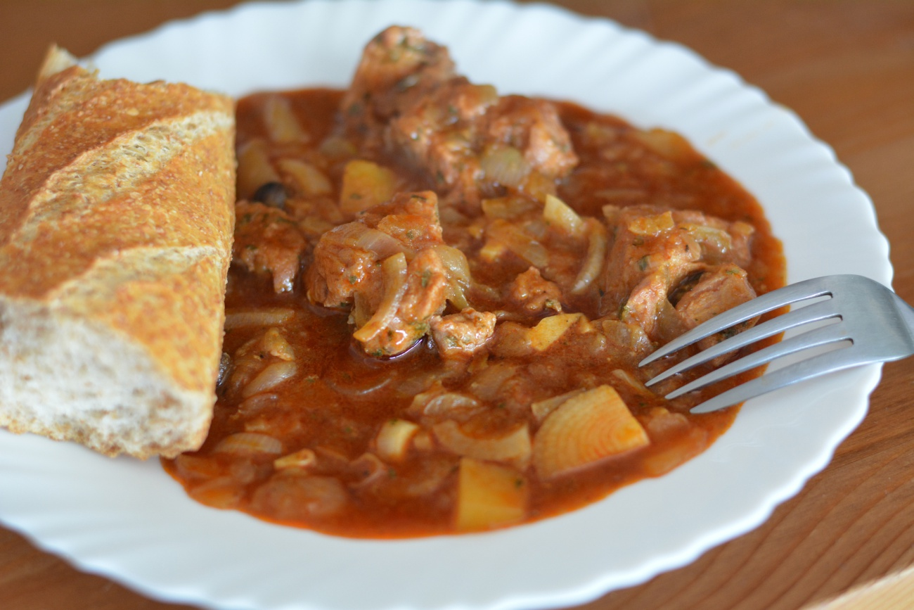 Traditional goulash with onion and bread
