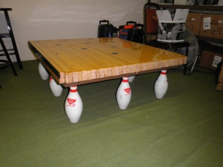 Solid maple coffee table made from a used bowling pin deck and used bowling pins.