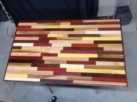 Table made of oak, black walnut, cherry, maple, purple heart, yellow heart, bloodwood, zebra wood, and paduk.