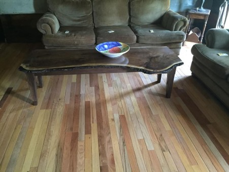My latest live edge black walnut coffee table sitting an a saved floor of maple red & white oak