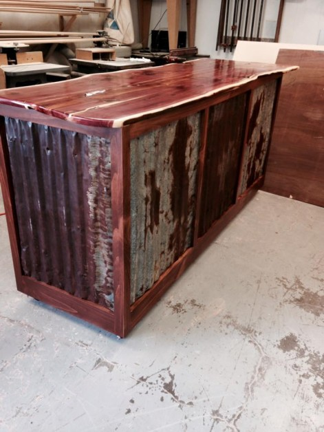 Red cedar top and some reclaimed barn tin.