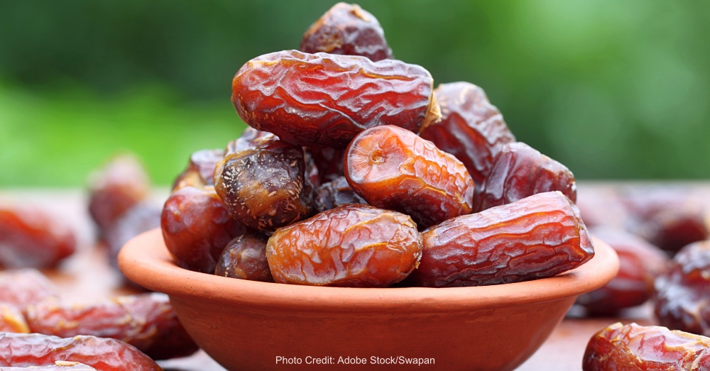 Fresh Arabian Dates with a brown bowl