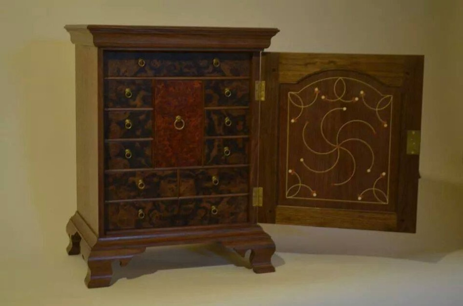Pennsylvania Spice Cabinet in walnut, adorned with red cedar and Holly inlay and poplar secondary stock. Veneered drawer fronts in walnut burl and bubinga burl.