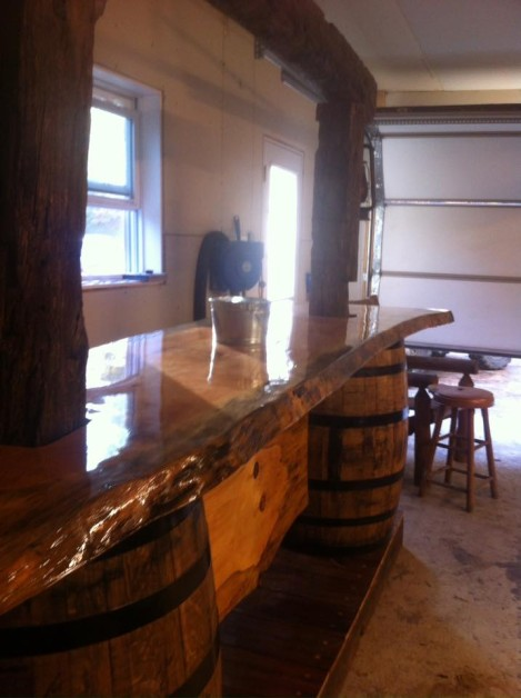 My first attempt of a slab top bar with Jim beam barrels for the legs and old pole barn beams on the top