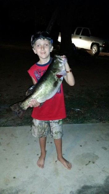 24 8 lb  bass my son caught this last Saturday evening with some help from dad at mcgee creek lake ok. Trolling a minnow from kayak