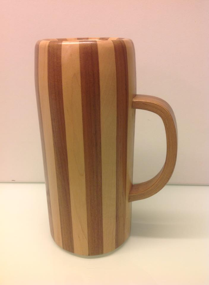 Hello Gentlemen! Very nice jug of Ben Hackney! I build something like that! Is one of my first jars, 15 years old! From Canadian Maple and American Walnut! Greetings from Bavaria!