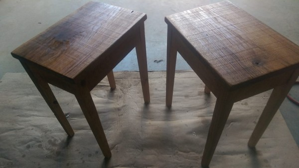 A couple of rustic end tables I made for the love of my life, my wife. The  tops are oak sides pine and legs are hemlock all rough cut left overs from building a cabin.