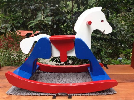 Rocking horse I just made for a friends baby shower. The body is maple veneer plywood the saddle is pine, the rocker rails and legs are heart redwood, and the spreader bars are Doug fir. Used up a bunch of material from the shop and then painted it Red, White and Blue.
